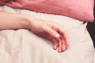 Woman's arm in bed