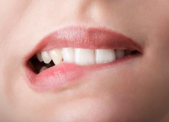 Biting her red lips teeth