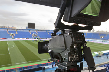 TV at the soccer. video camera back football goal