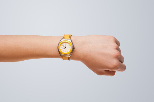 Hand with watch showing precise time
