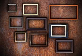 rusty wall full of empty frames