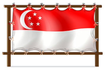 The flag of Singapore attached to the wooden frame