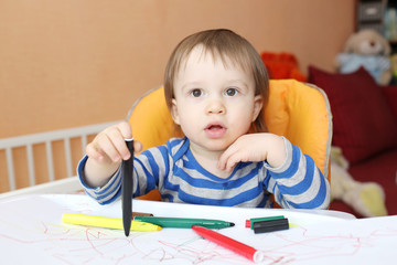 baby boy with pens at home