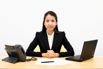 Thai business woman sitting on a desk
