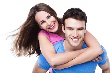 Man giving woman piggyback ride