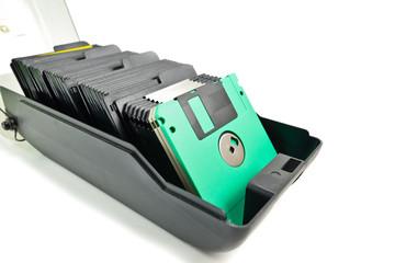 floppy disk in  dirty plastic box