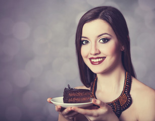 Young women with a cake.