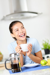 Woman drinking coffee having breakfast at home