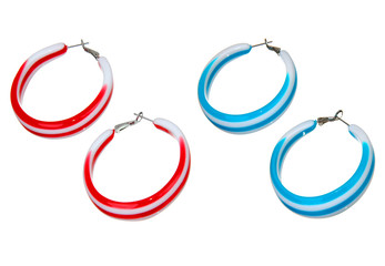 Wall Mural - blue and red plastic earrings isolated on white