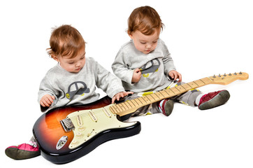Small children playing electric guitar