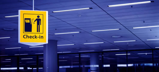Check-in sign at airport