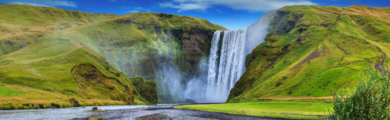 Fotobehang Watervallen beautiful torrent of skogafoss...