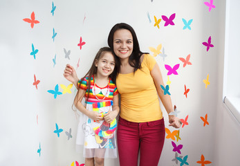 Close-up of a happy mother and her cute daughter in playroom