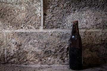old bottle on cement background