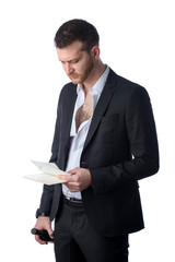frustrated depressed businessman looking at bills