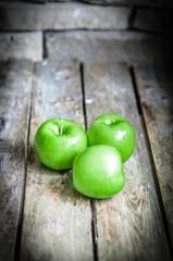 Fresh farm raised apples on rustic wooden background