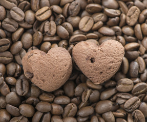cookies in the shape of heart on coffee beans