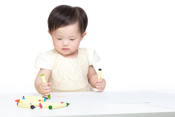 Asia little girl concentrate on drawing