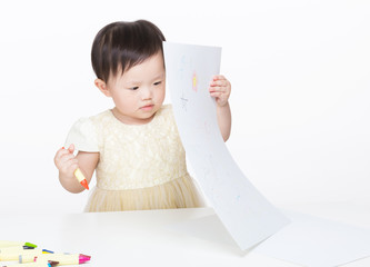 Asian baby girl concentrate on drawing