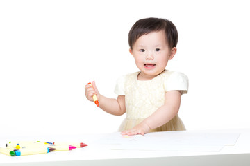 Asian baby girl drawing picture