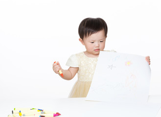 Asian baby girl looking at the picture