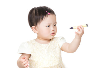 Asian baby girl holding crayon