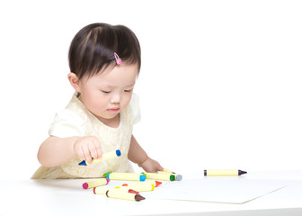 Asian little girl concentration on drawing