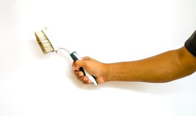 hand holding  toilet brush