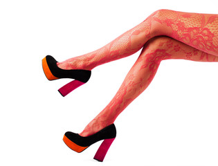 Women legs with red tights and high heel shoes