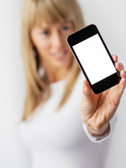 Woman showing blank mobile phone