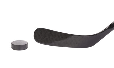 Black ice hockey stick and puck.