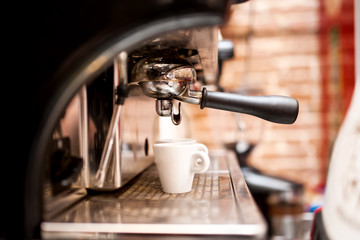 machine preparing espresso in coffee shop or bar