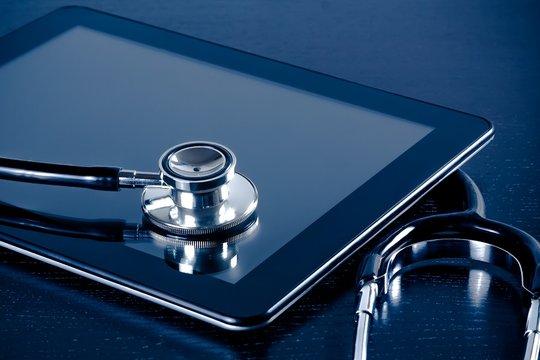 medical stethoscope on modern digital tablet pc in laboratory