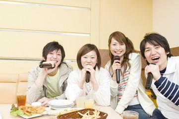 young people singing at karaoke