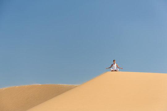 Yoga meditation on the beach, healthy female body in peace