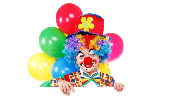 Boy clown holding the blank board