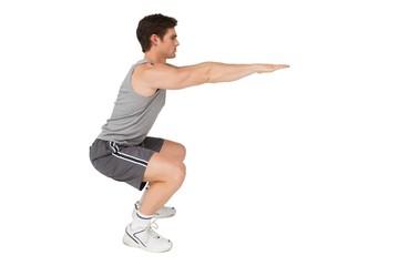 Fit man doing squats