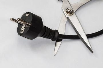 scissors cutting electric plug