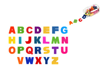 Alphabet written in multicolored plastic kids letters and colorf