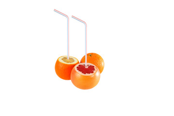 Oranges and grapefruit with drinking straw isolated on white.