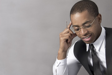 Young Black Man business thinking intensely
