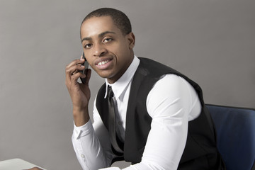 Black Business Man in office behind desk