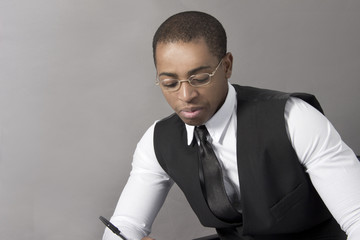 Black Business man writing a document