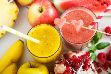 Fresh organic red and yellow smoothie with apple, watermelon, po