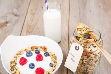 Fresh yoghurt with home made cereals and muesli, fresh raspberry