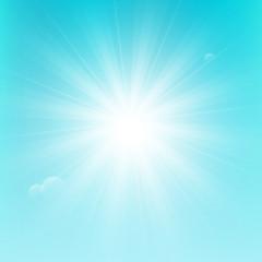 Shiny sun on blue sky background