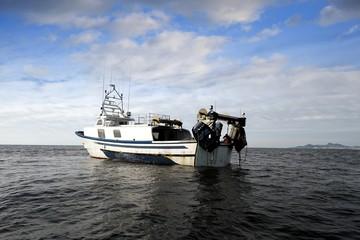 Trawler fishing boat stopped in open waters