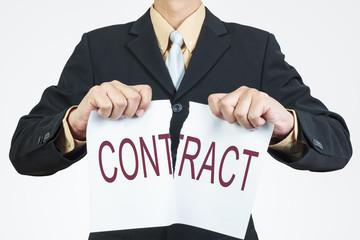 Businessman tearing sheet paper, contract management concept