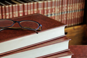 stack of books and glasses detail
