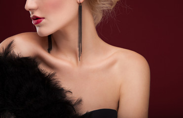 elegant Beautiful blonde lady with black feather fan.